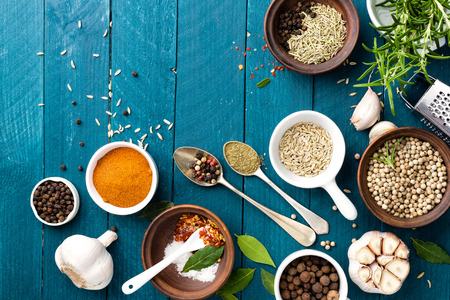 culinary: culinary background with spices on wooden table