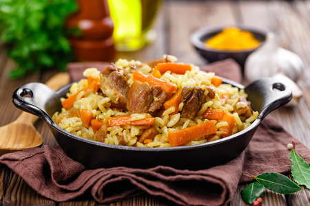 people eating: pilaf dish in a bowl