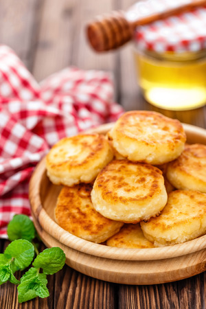 fritters: curd fritters on wooden table Stock Photo