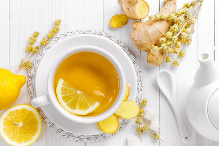 ginger flower plant: tea in a white cup with lemon and ginger Stock Photo