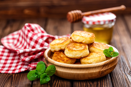 curd: curd fritters on wooden table Stock Photo