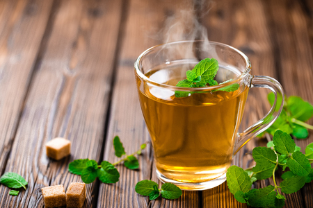 hot mint tea on wooden table