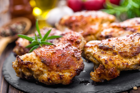 grilled chicken thighs prepared on wooden table