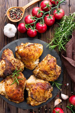 roasted chicken thighs prepared on wooden table