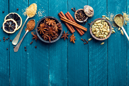 dark blue: culinary background with various spices for Christmas mulled wine