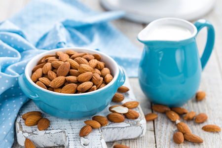 almond: Fresh almond milk and nuts, vegan drink Stock Photo