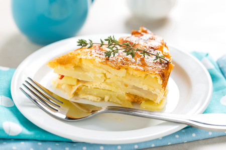 Potato breakfast gratin with parmesan Фото со стока