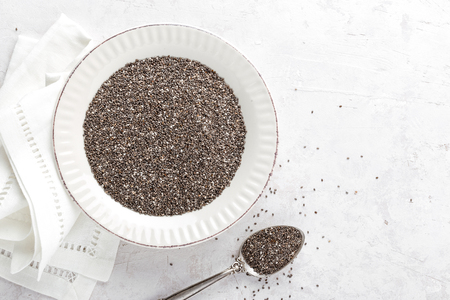 baclground: Chia seeds on white baclground directly above copy space Stock Photo