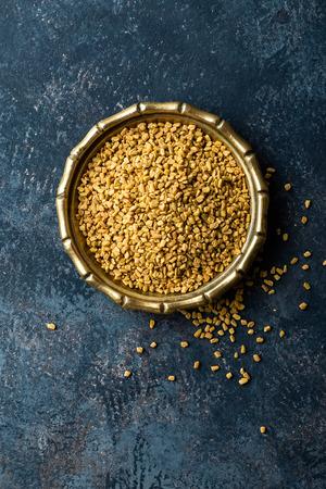 Fenugreek seeds on metal plate, spice, culinary ingredient Stock Photo
