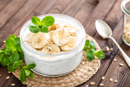 Fresh banana yogurt with oats, delicious dessert for healthy breakfast
