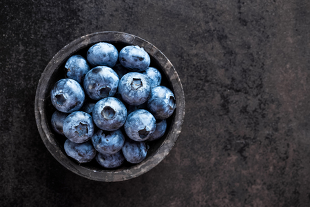 Blueberry on black background, top view