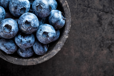 Fresh blueberry on black background, top view Zdjęcie Seryjne