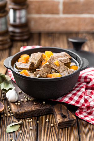 Delicious braised beef meat in broth with vegetables, goulash Фото со стока - 80047616