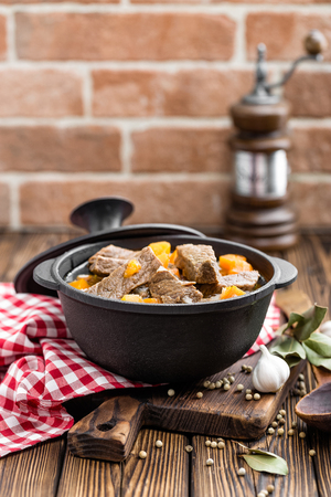 Delicious braised beef meat in broth with vegetables, goulash