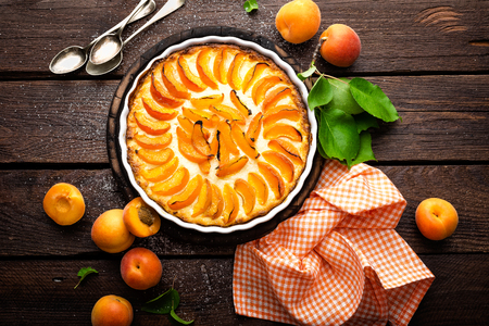 Apricot cake or pie with fresh fruits, cheesecake