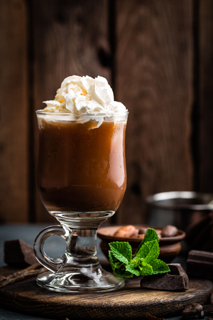 macchiato: Iced cocoa drink with whipped cream, cold chocolate beverage, coffee frappe on dark background Stock Photo