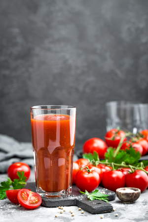 Tomato juice and fresh tomatoes Stock Photo