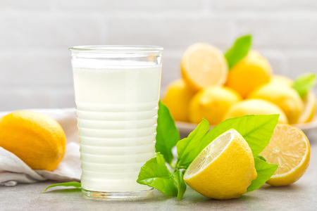 Lemonade. Drink with fresh lemons. Lemon cocktail with juice. Stock Photo