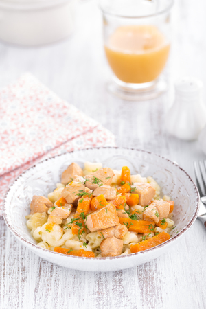 Braised chicken meat with carrot in sauce and pasta Stock Photo - 90544880