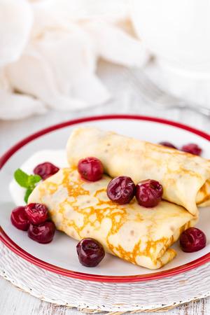 Sweet pancakes with cherry Stock fotó