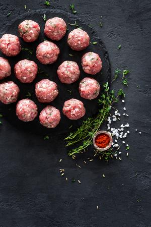 Raw meatballs on dark background, top view Stock Photo