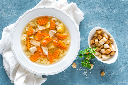 Chicken soup, boullion with meat, pasta and vegetables Stock Photo