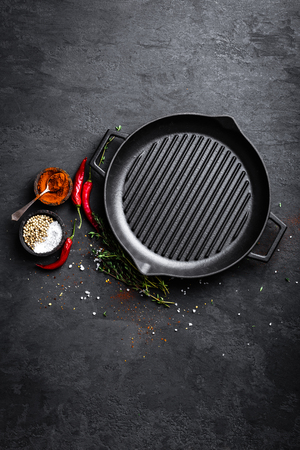 Empty cast-iron grill pan with ingredients for cooking on black background, top view Stock fotó - 91512919
