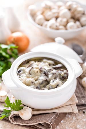 Mushrooms in creamy sauce, julienne. Champignon Stock Photo