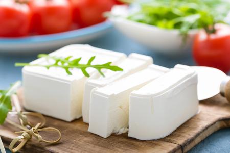 Feta cheese on board Reklamní fotografie