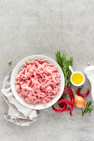 Mince. Ground meat with ingredients for cooking on light grey background. Top view Stok Fotoğraf