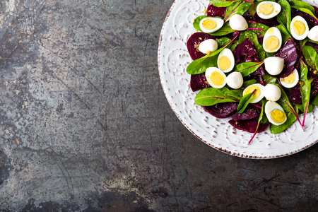 Fresh vegetable salad with boiled beet, mangold leaves, walnuts and quail eggs Stock Photo - 95280261