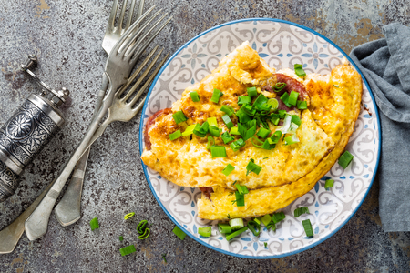 Omelet or omelette with fresh green onion, scrambled eggs