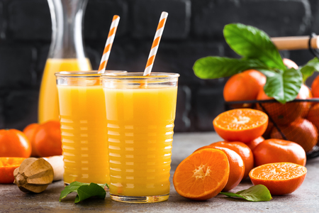 Mandarin orange juice. Refreshing summer drink. Fruit refreshment beverage