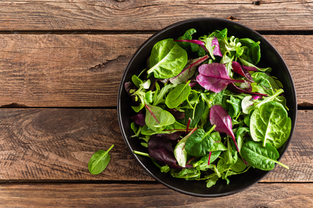 Fresh salad mix of baby spinach, arugula leaves, basil and chard. Italian cuisine Stock Photo
