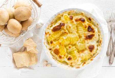 Baked potato gratin with garlic, cream and parmesan cheese