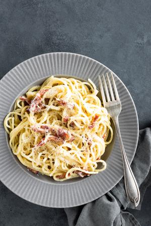 Carbonara pasta, spaghetti with pancetta, egg, hard parmesan cheese and cream sauce. Traditional italian cuisine. Pasta alla carbonara Stock Photo