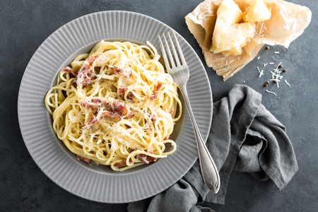 Carbonara pasta, spaghetti with pancetta, egg, hard parmesan cheese and cream sauce. Traditional italian cuisine. Pasta alla carbonara Stock Photo