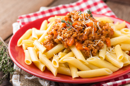 Pasta bolognese. Pasta served with a sauce of ground beef meat, tomato, onion, carrot and thyme. Traditional italian cuisine