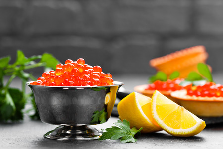 Red salmon fish caviar, salmon caviar in metal bowl. Caviar. Selective focus
