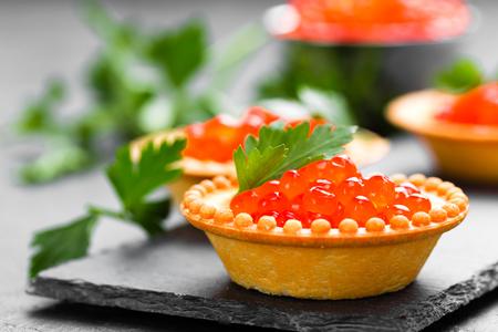 Tartalets with red salmon fish caviar, salmon caviar. Caviar. Selective focus