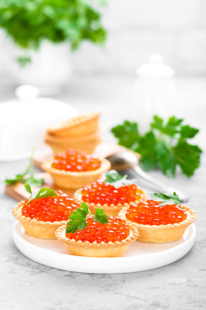 Tartlets with red salmon fish caviar