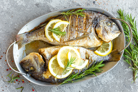 Baked fish dorado. Sea bream or dorada fish grilled Stockfoto - 99454347