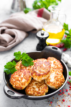Cutlets. Fried cutlets in cast-iron pan on table Stock Photo