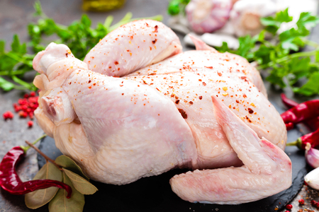 Raw chicken. Fresh whole chicken with ingredients for cooking Stock Photo