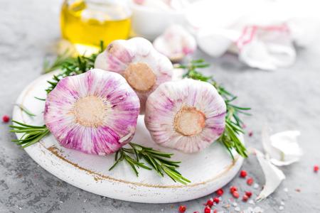 Garlic. Fresh garlic, oil and rosemary on kitchen table