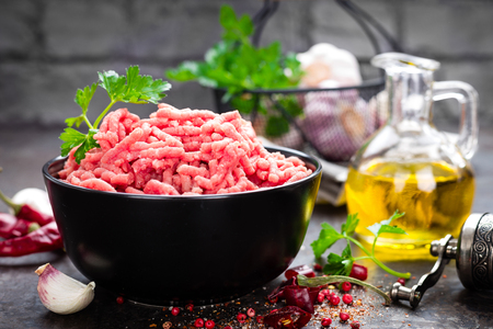 Raw ground beef meat with ingredients for cooking. Fresh minced meat