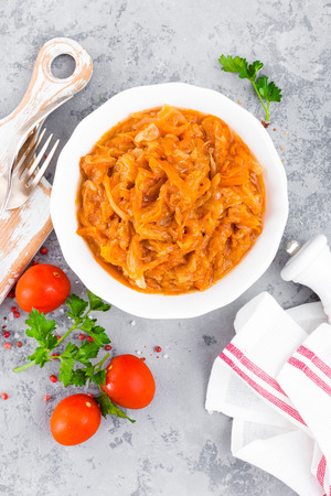 Cabbage stew. Cabbage braised in tomato sauce Stock Photo