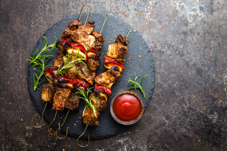 Grilled meat skewers, shish kebab with onion and sweet pepper Stock Photo