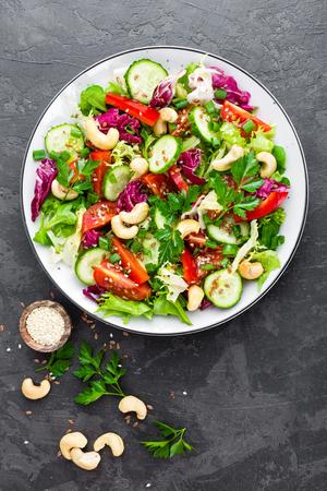 Vegetable salad. Fresh salad with vegetables and nuts. Vegetable salad on plate. Healthy vegetarian food Standard-Bild - 101277892