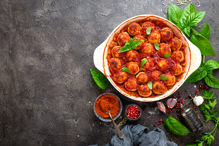 Meatballs. Meatballs in tomato sauce with carrot and onion